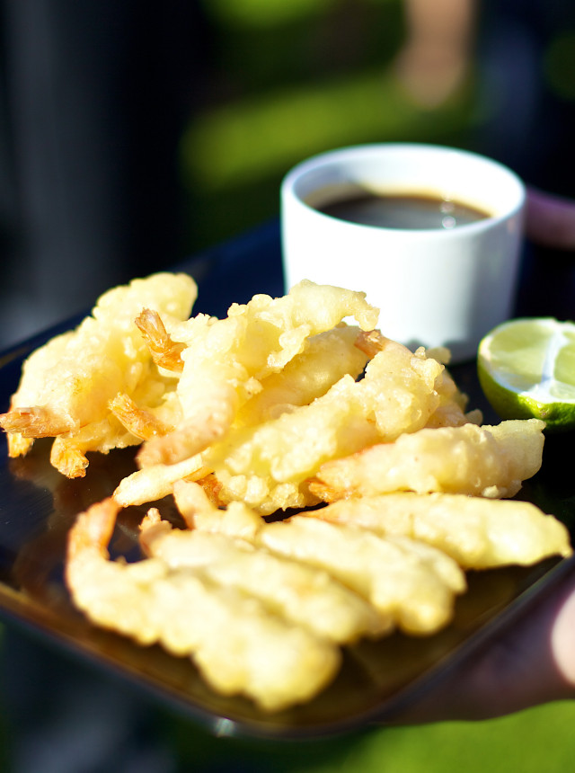 Battered prawns with a dipping sauce for a corporate event.