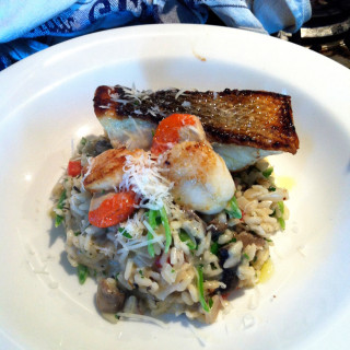 Photo of a seafood risotto with parmesan cheese, created by Beetham Food.