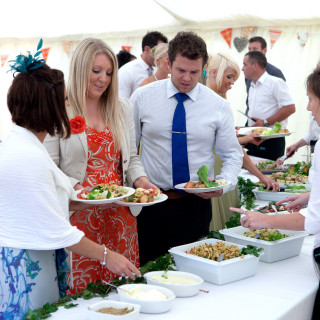Photo of guests enjoying a wedding buffet catered by Beetham Food.